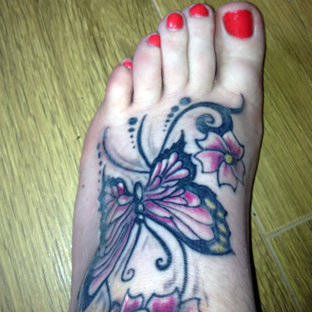 Beautiful coral toes, and my new butterfly. But look at those toes!